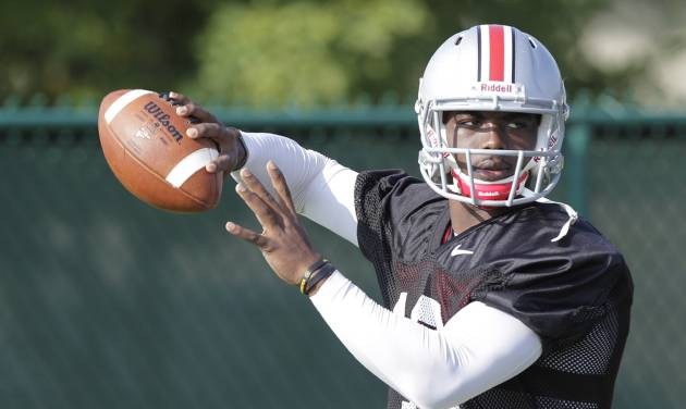 FILE - This Saturday, Aug. 9, 2014, file photo shows Ohio State quarterback J.T. Barrett throwing a pass during an NCAA college football practice in Columbus, Ohio. Barrett, a redshirt freshman who's never taken a collegiate snap, is set to start when the Buckeyes open their season on Aug. 30 against Navy. Braxton Miller, a two-time Big Ten player of the year, tore the labrum of his (right) throwing shoulder on an unrushed, seven-yard pass on Monday. (AP Photo/Jay LaPrete, File)