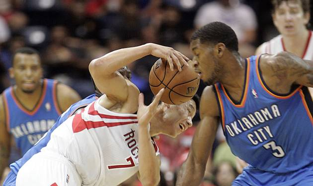 Houston Rockets' Jeremy Lin tries to control ball away from Oklahoma City Thunder defender Perry Jones during the second quarter of an NBA preseason basketball game in Hidalgo, Texas, Wednesday, Oct. 10, 2012. (AP Photo/Delcia Lopez)