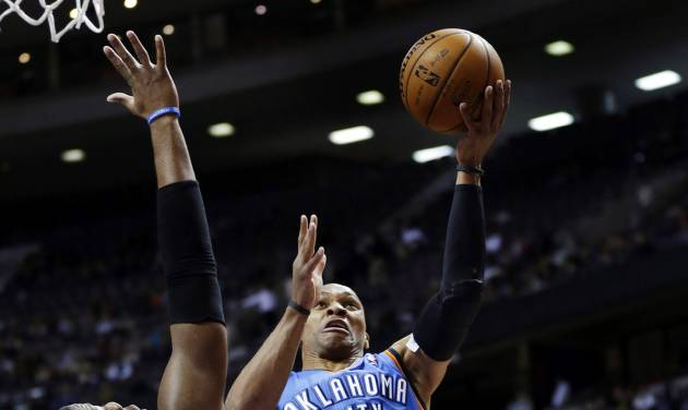 Oklahoma City Thunder guard Russell Westbrook (0) drives on Detroit Pistons center Greg Monroe (10) in the first half of an NBA basketball game in Auburn Hills, Mich., Monday, Nov. 12, 2012. (AP Photo/Paul Sancya)