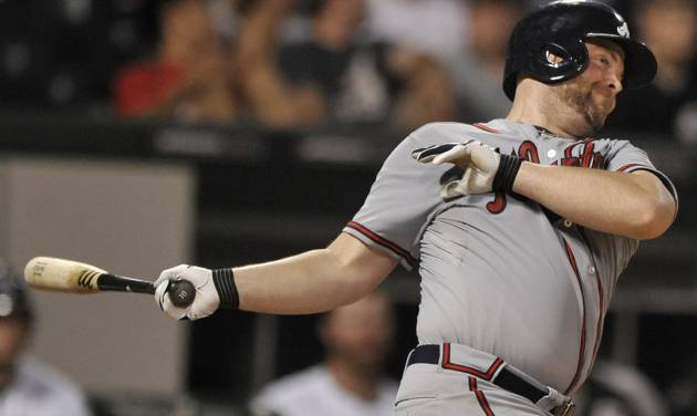 Atlanta Braves' Brian McCann watches his three-run home run during the sixth inning of a baseball game against the Chicago White Sox in Chicago, Friday, July 19, 2013. (AP Photo/Paul Beaty)