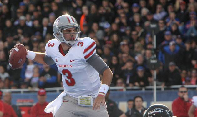 UNLV's Nick Sherry, left, is pressured by Boise State's Tyler Horn before throwing an incomplete pass an NCAA college football game Saturday, Oct. 20, 2012, in Boise, Idaho. (AP Photo/Idaho Statesman, Joe Jaszewski) LOCAL TV OUT (KTVB 7)