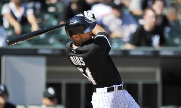 Chicago White Sox's Alex Rios watches his grand slam home run during the third inning of an interleague baseball game against the Atlanta Braves, Saturday, July 20, 2013, in Chicago. (AP Photo/Paul Beaty)