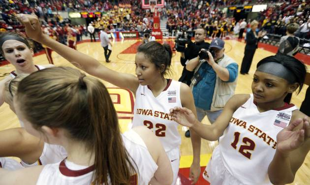 Iowa State's Brynn Williamson, center, and Seanna Johnson, right, celebrate with teammates after their 83-70 victory over Iowa in an NCAA college basketball game, Thursday, Dec. 12, 2013, in Ames, Iowa. Williamson scored 21 points to lead Iowa State in the victory. (AP Photo/Charlie Neibergall)