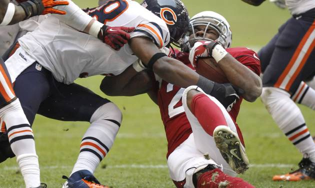 Arizona Cardinals running back Alfonso Smith is hit by Chicago Bears outside linebacker Geno Hayes, left, during the first half of an NFL football game, Sunday, Dec. 23, 2012, in Glendale, Ariz. (AP Photo/Paul Connors)