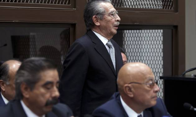Guatemala's former dictator Jose Efrain Rios Montt, top, attends his hearing in Guatemala City, Monday, Jan. 28, 2013. Rios Montt, a former U.S.-backed dictator who presided over one of the bloodiest periods of Guatemala's civil war, will stand trial on charges he ordered the murder, torture and displacement of thousands of Mayan Indians, a judge ruled Monday. (AP Photo/Moises Castillo)