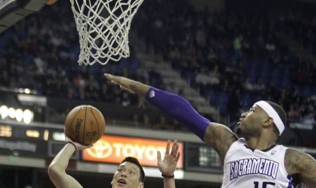 Houston Rockets guard Jeremy LIn, right, shoots against Sacramento Kings center DeMarcus Cousins during the first quarter of an NBA basketball game in Sacramento, Calif., Sunday, Feb. 10, 2013.(AP Photo/Rich Pedroncelli)