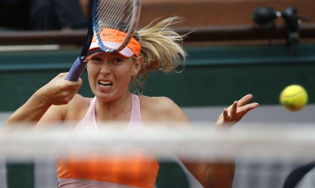 Russia's Maria Sharapova returns the ball to Argentina's Paula Ormaechea during the third round match of  the French Open tennis tournament at the Roland Garros stadium, in Paris, France, Friday, May 30, 2014. (AP Photo/Michel Euler)