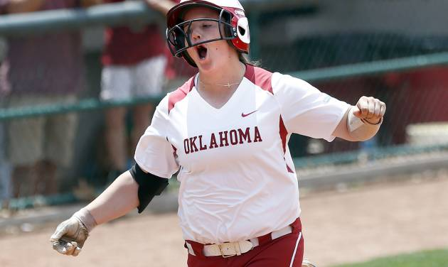 OU's Brittany Williams celebrates a home run in the first inning of the Sooners' 11-3 Bedlam win over OSU on Sunday.                     Photo by Sarah Phipps, The Oklahoman