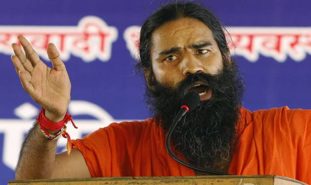 Indian yoga guru Baba Ramdev gestures as he speaks to his supporters at an anti-corruption protest in New Delhi, India, Sunday, Aug. 12, 2012. Ramdev fasted for a fourth day Sunday and threatened to expand his protest nationwide if the government doesn't act decisively to bring back billions of dollars of ill-gotten money that some Indians have allegedly stashed abroad. (AP Photo/Rajesh Kumar Singh)
