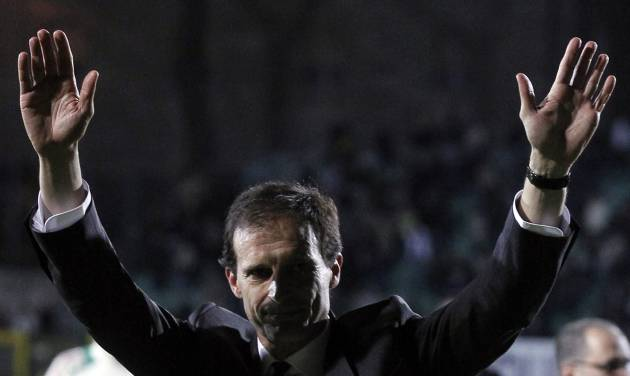 AC Milan coach Massimiliano Allegri waves to fans at the end of a Serie A soccer match between Siena and AC Milan, in Siena, Italy, Sunday, May 19, 2013. (AP Photo/Paolo Lazzeroni)
