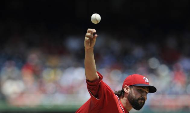 Washington Nationals starting pitcher Tanner Roark delivers during the first inning of a baseball game against the Atlanta Braves, Sunday, June 22, 2014, in Washington. (AP Photo/Nick Wass)