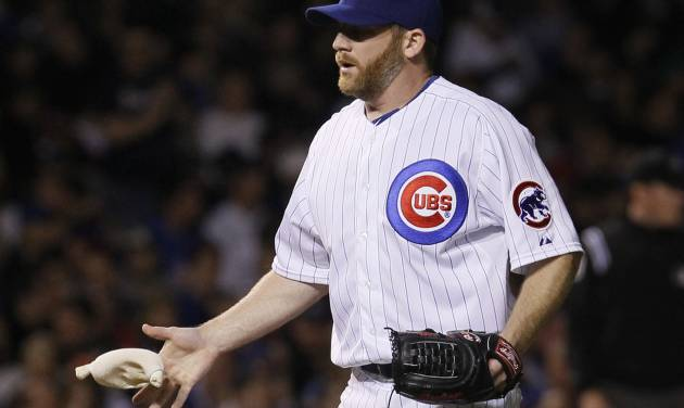 Chicago Cubs starting pitcher Ryan Dempster goes to the rosin bag during the sixth inning of a baseball game against the Atlanta Braves Tuesday, May 8, 2012, in Chicago. (AP Photo/Charles Rex Arbogast)