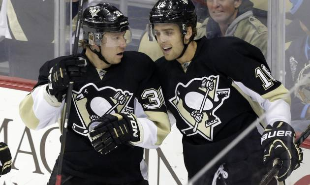 Pittsburgh Penguins' Jussi Jokinen, left, celebrates his first-period goal with teammate Brandon Sutter during an NHL hockey game against the New York Islanders in Pittsburgh, Friday, Oct. 25, 2013. (AP Photo/Gene J. Puskar)
