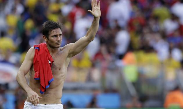 England's Frank Lampard waves to England fans after the group D World Cup soccer match between Costa Rica and England at the Mineirao Stadium in Belo Horizonte, Brazil, Tuesday, June 24, 2014.  The match ended in a 0-0 draw.  (AP Photo/Matt Dunham)