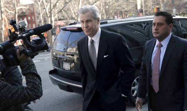 Macy's Chairman, President and CEO Terry Lundgren arrives to court in New York, Monday, Feb. 25, 2013. Lundgren is scheduled to testify in New York State Supreme Court on Monday in a trial that pits the department store chain against rival J.C. Penney Co. over a partnership with home diva Martha Stewart. (AP Photo/Seth Wenig)