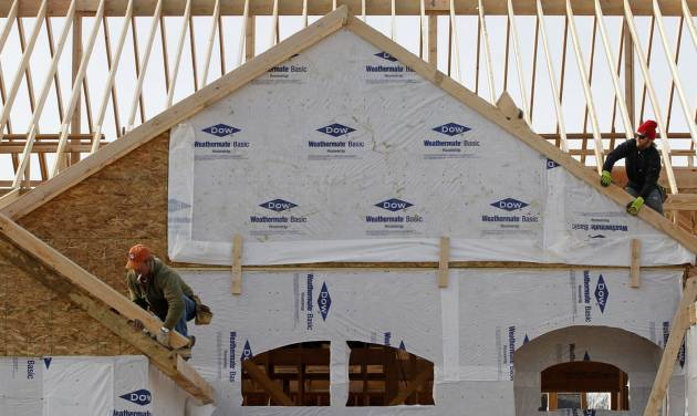 "In this Thursday, Dec. 6, 2012 photo a new home is constructed in Pepper Pike, Ohio. A measure of the U.S. economy designed to signal future activity increased in December from November, suggesting growth may strengthen in 2013. ""Housing, which has long been a drag, has turned into a positive for growth, and will help improve consumer balance sheets and strengthen consumption,"" Conference Board economist Kenneth Goldstein said. (AP Photo/Tony Dejak)"