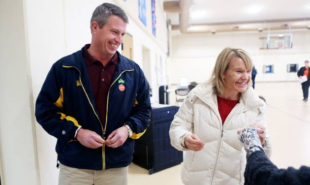 Republican U.S. Senate candidate Kurt Bills and his wife Cindy joke with an election official after they cast their ballots at Lutheran Church of Our Savior in Rosemount, Minn. Tuesday, Nov. 6, 2012. Bills faces Democratic Sen. Amy Klobuchar. (AP Photo/Minnesota Public Radio, Jeffrey Thompson)