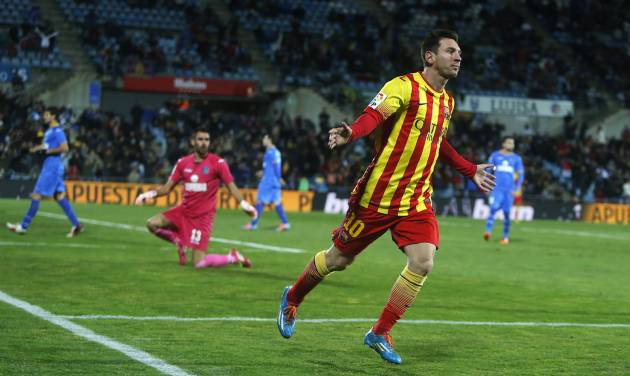 Barcelona's Lionel Messi celebrates his goal during a Spanish Copa del Rey match between FC Barcelona and Getafe at the Coliseum Alfonso Perez stadium in Madrid, Spain, Thursday, Jan. 16, 2014. (AP Photo/Andres Kudacki)
