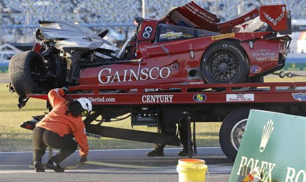 The GAINSCO Corvette DP is loaded on to a wrecker after driver Memo Gidley was involved in a crash during the IMSA Series Rolex 24 hour auto race at Daytona International Speedway in Daytona Beach, Fla., Saturday, Jan. 25, 2014. (AP Photo/John Raoux)