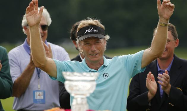 Bernhard Langer of Munich, Germany acknowledges the gallery after winning the  Senior Players Championship golf tournament at Fox Chapel Golf Club in Pittsburgh, Sunday, June 29, 2014. Langer defeated Jeff Sluman in the second hole of a playoff to win the tournament. (AP Photo/Gene J. Puskar)