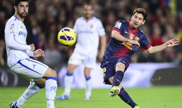 FC Barcelona's Lionel Messi, from Argentina scores his second goal against Zaragoza during a Spanish La Liga soccer match a at the Camp Nou stadium in Barcelona, Spain, Saturday, Nov. 17, 2012. (AP Photo/Manu Fernandez)