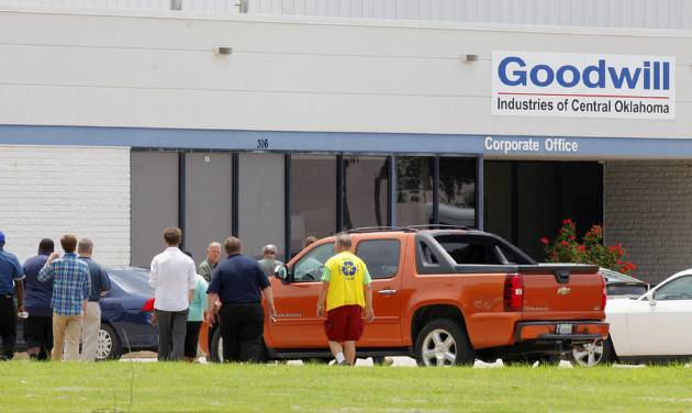 Employees return to work at Goodwill Industries, at 316 S Blackwelder Ave., after evacuating the building due to a bomb scare over two grenades found there in Oklahoma City Thursday, June 26, 2014.  Photo by Paul B. Southerland, The Oklahoman