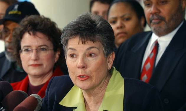 FILE - In this April 10, 2003, file photo, Martha Burk, center, chair of the National Council of Women's Organizations, speaks to media in Atlanta while flanked by Martin Luther King III, right, and Kim Gandy, left, president of the National Organization of Women, as Burk discussed her next move in protesting the male-only membership policy of the Augusta National Golf Club. The appointment of a new chief executive at IBM has revived the debate over Augusta National's all-male membership just one week before the Masters. IBM hired Virginia Rometty as its CEO this year. The last four CEOs of IBM have been members of Augusta, but the club has never had a female member since it was founded in 1933. Burk says Augusta National and IBM now are in a bind. She says IBM could end up undermining its new CEO if it doesn't fight for her admittance. (AP Photo/Gregory Smith, File)