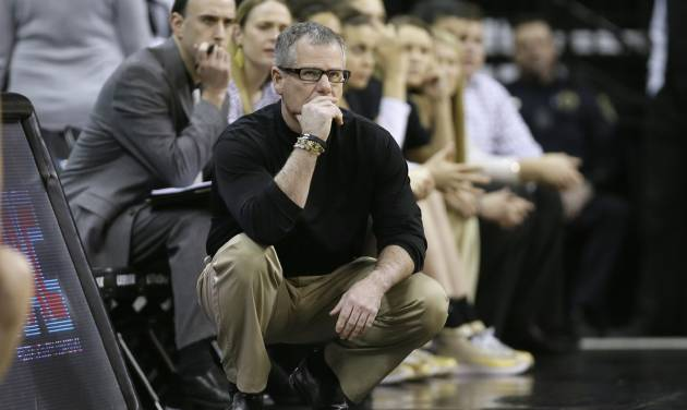 Idaho head coach Jon Newlee looks on during the second half of an NCAA tournament first-round women's college basketball game against Louisville, Sunday, March 23, 2014, in Iowa City, Iowa. Louisville won 88-42. (AP Photo/Charlie Neibergall)