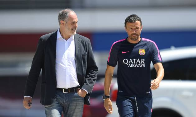 FC Barcelona's coach Luis Enrique, right, and Sports director Andoni Zubizarreta arrive for a press conference at the Sports Center FC Barcelona Joan Gamper in San Joan Despi, Spain, Wednesday, July 16, 2014. Enrique takes charge of the squad on Tuesday when the team begins training for the 2014/15 season. (AP Photo/Manu Fernandez)