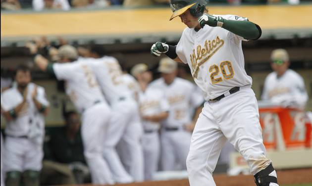 Oakland Athletics' Josh Donaldson scores after hitting a 2 run home run against San Francisco Giants starting pitcher Madison Bumgarner during the fourth inning of a baseball game in Oakland, Calif., Monday, May 27, 2013. (AP Photo/Tony Avelar)