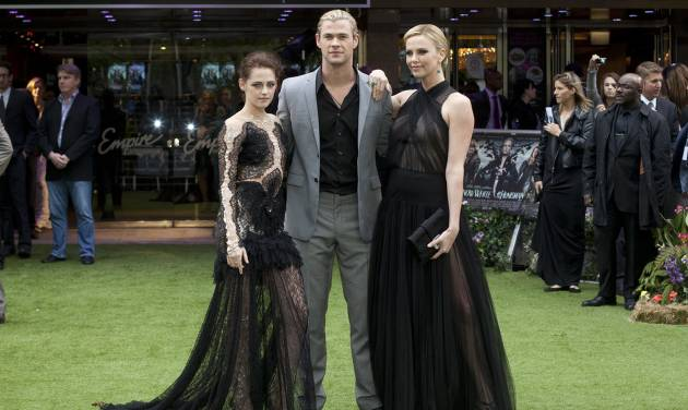 Actors Kristen Stewart, left, with Charlize Theron, right and Chris Hemsworth pose for the media at the World Premiere of the film Snow White and the Huntsman at a cinema in central London, Monday, May 14, 2012. (AP Photo/Alastair Grant)