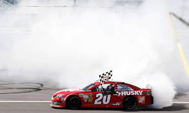 Matt Kenseth (20) performs a burnout after winning the NASCAR Sprint Cup Series auto race at Kansas Speedway in Kansas City, Kan., Sunday, April 21, 2013. (AP Photo/Orlin Wagner)