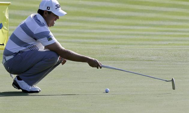 """In this Aug. 25, 2013 photo, Erik Compton looks at his putt on the first hole during the final round of The Barclays golf tournament in Jersey City, N.J. """"Some guys focus like every hole is the last hole. And I need to play like that every week,"""" Compton said. """"Your energy level plays a major factor in how your think. Sucking it up, basically that's what I've been doing my life _ figuring out how to play golf when you're not at your best."""" (AP Photo/Mel Evans)"""