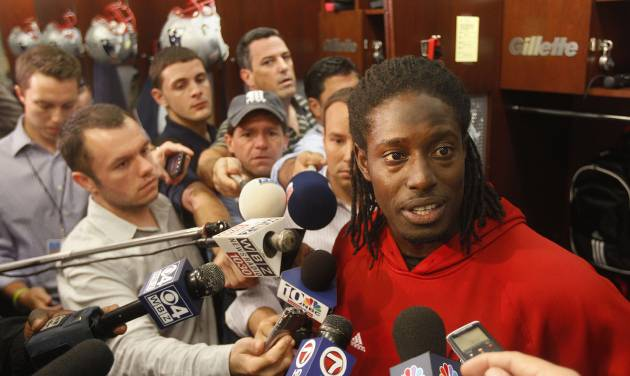 FILE - This Sept. 26, 2012 file photo shows New England Patriots wide receiver Deion Branch responding to a reporter's question during a media availability in front of his locker at the NFL football team's facility in Foxborough, Mass. The Patriots have re-signed Branch for their battered corps of wide receivers. They signed him for the second time this season on Wednesday, Dec. 12, 2012. (AP Photo/Stephan Savoia, File)