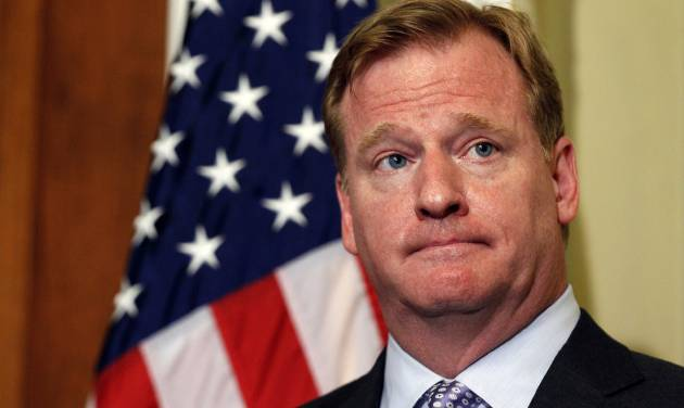 NFL Commissioner Roger Goodell stands during a media availability after a meeting with Democratic Whip Sen. Dick Durbin, D-Ill., left, to discuss bounty programs, on Capitol Hill Wednesday, June 20, 2012 in Washington. (AP Photo/Alex Brandon)
