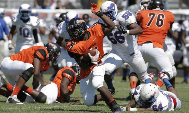 SOUL BOWL: Douglass's Chavez Wyatt (5) runs the ball during a high school football game between Douglass and Millwood in Oklahoma City, Saturday, Sept. 8, 2012.  Photo by Garett Fisbeck, The Oklahoman