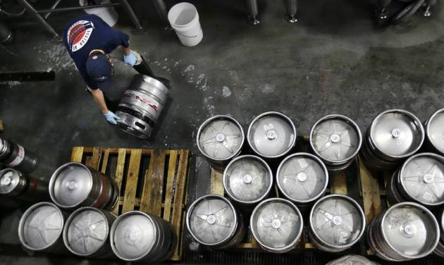 FILE - In this July 1, 2013, file photo, brewer Ken Hermann rolls a fresh keg of beer onto pallets at the Harpoon Brewery in the Seaport District of Boston. The Commerce Department releases its report on business inventories for May 2014 on Tuesday, July 14, 2014. (AP Photo/Charles Krupa, File)