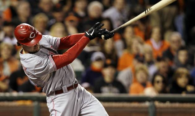 Cincinnati Reds' Ryan Ludwick hits a solo home run in the second inning during Game 2 of the National League division baseball series against the San Francisco Giants in San Francisco, Sunday, Oct. 7, 2012. (AP Photo/Eric Risberg)