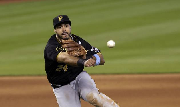 Pittsburgh Pirates third baseman Pedro Alvarez (24) throws to first base after fielding a ground ball hit by Miami Marlins' Jeff Mathis, bottom, in the ninth inning of a baseball game in Miami, Sunday, June 15, 2014. Mathis was out at first base. The Marlins won 3-2. (AP Photo/Alan Diaz)