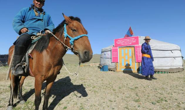 A nomad voter arrives at a yurt temporarily serving as a polling station in Hovt, western Mongolia, Thursday, June 28, 2012. Mongolians are voting for a new legislature, going to the polls by foot, car and even horse for an election centered on how best to distribute the benefits of Mongolia's mining boom. (AP Photo/Kyodo News) JAPAN OUT, MANDATORY CREDIT, NO LICENSING IN CHINA, HONG KONG, JAPAN, SOUTH KOREA AND FRANCE