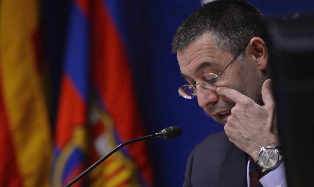 FC Barcelona's President Josep Maria Bartomeu gestures during a press conference at the Camp Nou stadium in Barcelona, Spain, Friday, Jan 24, 2014. Barcelona says its board of directors is calling an ''extraordinary'' meeting, fueling Spanish media reports that club president Sandro Rosell is under pressure to consider stepping down due to the lawsuit regarding Neymar's transfer. Barcelona said in a statement that the meeting will take place on Thursday afternoon, a day after a judge agreed to hear a lawsuit brought by a Barcelona club member over the cost of Neymar's signing. (AP Photo / Manu Fernandez)