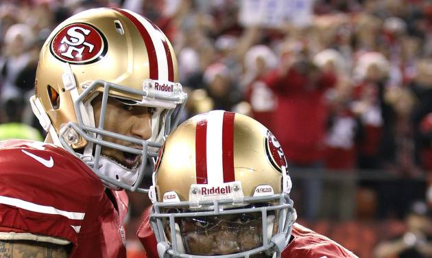 San Francisco 49ers wide receiver Anquan Boldin (81) celebrates with quarterback Colin Kaepernick (7) after scoring on a 10-yard touchdown reception against the Atlanta Falcons during the second half of an NFL football game in San Francisco, Monday, Dec. 23, 2013. (AP Photo/Tony Avelar)