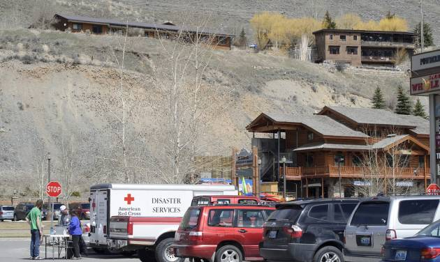 Displaced residents of Budge Drive in Jackson, Wyo. register with the American Red Cross on Thursday, April 10, 2014 as geologists study the hillside on East Gros Ventre Butte where the potential for a landslide called for an evacuation the night before. (AP Photo/Jackson Hole News and Guide, Price Chambers)