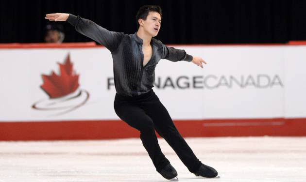 Patrick Chan competes during the men's short program at the Canadian Figure Skating Championships, Friday, Jan. 10, 2014, in Ottawa, Ontario. Chan was in first place following the program. (AP Photo/The Canadian Press, Sean Kilpatrick)