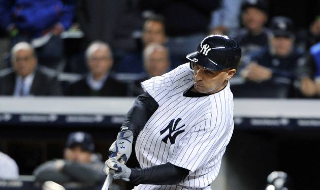 New York Yankees' Raul Ibanez hits a home run during the ninth inning of Game 3 of the Yankees' American League division baseball series against the Baltimore Orioles on Wednesday, Oct. 10, 2012, in New York. (AP Photo/Bill Kostroun)
