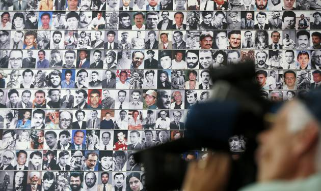 A wall of photographs of journalists killed while reporting the news lines a wall during the rededication of the Journalists Memorial at the Newseum in Washington, Monday, June 9, 2014. The memorial, which recognizes journalists killed while covering the news, added 10 names of journalists who were killed in 2013. (AP Photo/Charles Dharapak)