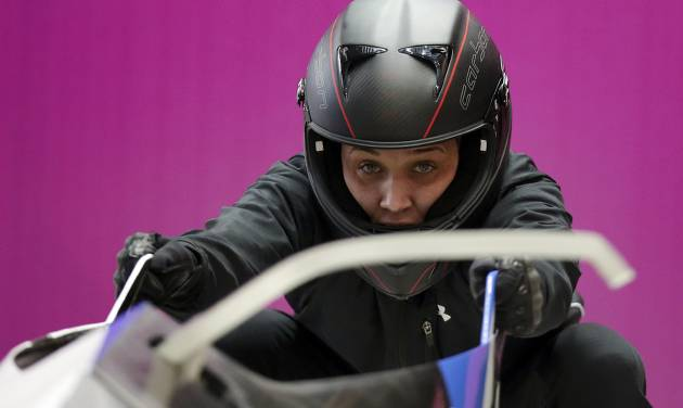 Breakman Lolo Jones of the United States prepares for a training session with her teammate Jazmine Fenlator for the women's bobsleigh at the 2014 Winter Olympics,  Sunday, Feb. 16, 2014, in Krasnaya Polyana, Russia. (AP Photo/Michael Sohn)