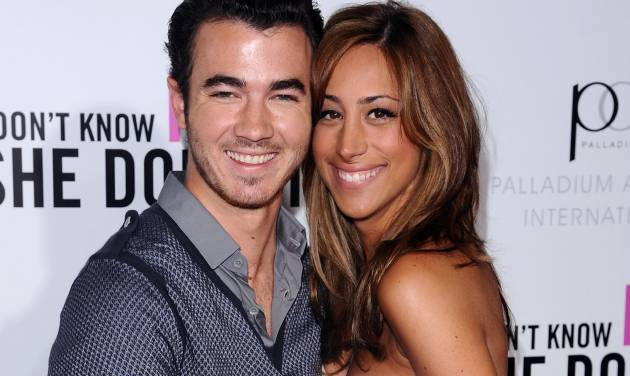 """FILE - This Sept. 12, 2011 file photo shows Singer Kevin Jonas, left, and his wife Danielle Deleasa attend the Cinema Society premiere of """"I Don't Know How She Does It"""", in New York. The couple star in a new reality show, """"Married to Jonas,"""" produced by Ryan Seacrest Productions. It premieres Sunday, Aug. 19 at 10 p.m. EST on E!. (AP Photo/Peter Kramer, file)"""