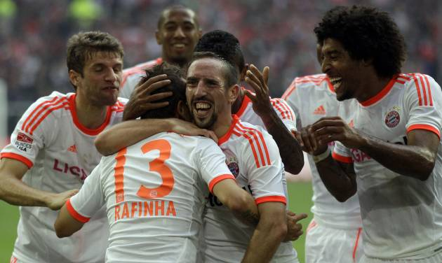 Munich teammates celebrate after scoring during the German first division Bundesliga soccer match between Fortuna Duesseldorf and Bayern Munich in Duesseldorf, Germany, Saturday, Oct. 20, 2012. Munich won by 5-0. (AP Photo/Frank Augstein)