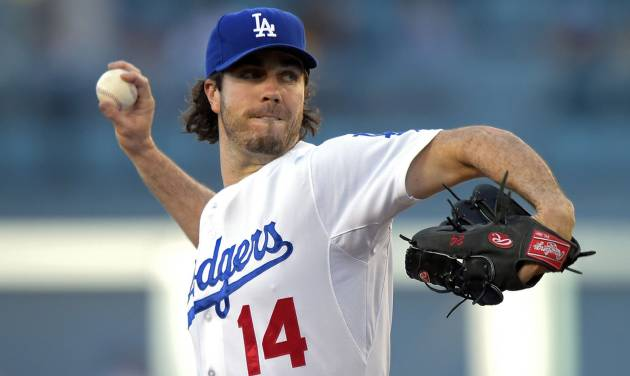 Los Angeles Dodgers starting pitcher Dan Haren throws to the plate during the first inning of a baseball game against the San Diego Padres, Friday, July 11, 2014, in Los Angeles. (AP Photo/Mark J. Terrill)